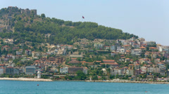 Panorama of hill, wood, buildings and fortress wall Stock Footage