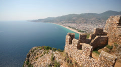 Cliff in sea, fragment of fortress wall, sea and beach Stock Footage