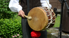 Drummer play folk music with drum and stick in village party Stock Footage