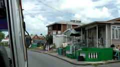 Barbados Bridgetown and neighborhood 003 poor residential houses along highway Stock Footage