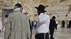 Street conversation between tourists and Jerusalem inhabitant near Western Wall. Stock Footage