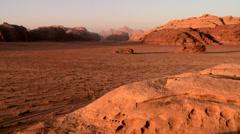 A wide establishing shot of the vast desert sands of Wadi Rum, Jordan. - stock footage