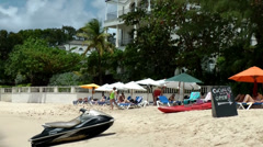 Barbados Paynes bay 023 a jet ski lies on the beach, a nice hotel in background - stock footage