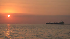 Big ship anchored in the sunrise - stock footage