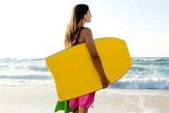 girl with her bodyboard - stock photo