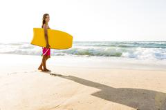 Girl with her bodyboard Stock Photos