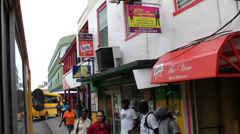 Barbados Bridgetown and neighborhood 041 arriving downtown with a public bus Stock Footage