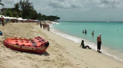 Barbados Paynes bay 021 a freaky air mattress on the sands Stock Footage