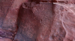 Stock Video Footage of Ancient and mysterious petroglyphs adorn the walls of a cave in the Saudi desert