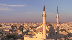 Beautiful generic wide shot of a mosque towering above the Arab city of Madaba Stock Footage