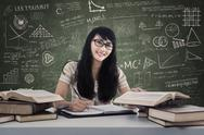Stock Illustration of beautiful female student writing in class