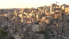 Houses cluster together on the hillsides of Amman, Jordan. Stock Footage