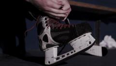 Team Sport - Ice Hockey - Lacing up skates before the game. - stock footage