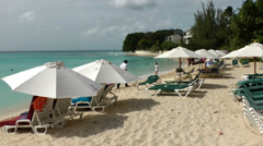 Barbados Paynes bay 032 a row of beach umbrellas on finest sands Stock Footage