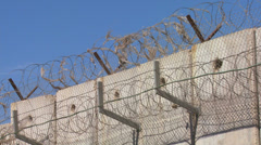 Barbed wire adorns the top of the new West Bank Barrier between Israel and the Stock Footage