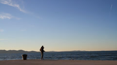 Couple walking together by the Sea in Zadar Stock Footage