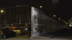 094 Berlin, East side gallery, Urban style, the wall at night - stock footage