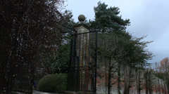 Wall & gate to mansion (dolly) - stock footage