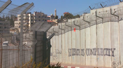 Graffiti and barbed wire line the new West Bank Barrier between Israel and the Stock Footage
