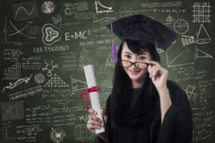 Asian female graduate in class with certificate Stock Illustration