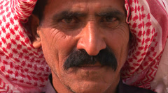 Close up of a face of a Palestinian Bedouin man in headscarf. Stock Footage