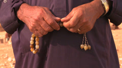 Tilt up to a close up of the face of a Bedouin man in Palestine. Stock Footage