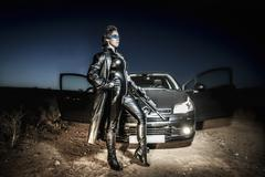 Fighter, dangerous woman dressed in black latex, armed with gun. comic style Stock Photos