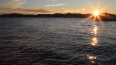 Beautiful sunset on the surface of the sea and ship in Zadar Stock Footage
