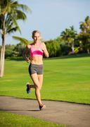 young woman jogging running outdoors - stock photo
