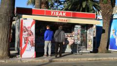 People buying things at street kiosk in Split Stock Footage