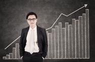 Stock Illustration of businessman and growing bar chart