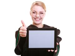 woman lawyer attorney in classic polish gown holds tablet blank - stock photo