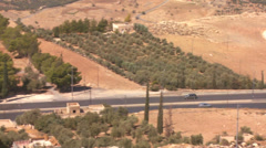 A car drives along a highway and we reveal to see the Dead Sea region of Jordan. - stock footage