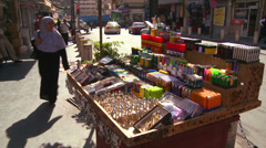 Man goods are for sale from a street cart in Amman, Jordan. - stock footage