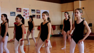 Stock Video Footage of little girls repeats movement on ballet