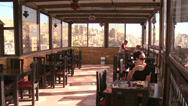 Stock Video Footage of Tourists dine at a rooftop restaurant in Amman, Jordan.