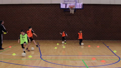 Children playing football or soccer, training in sports hall Stock Footage