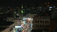 A high angle night view over traffic in downtown Amman, Jordan. Stock Footage