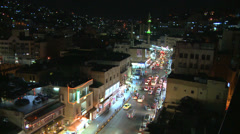 A high angle night view over traffic in downtown Amman, Jordan. - stock footage