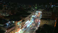 Stock Video Footage of A high angle night view over traffic in downtown Amman, Jordan.