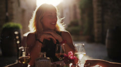 Blond woman talks with girlfriends Stock Footage