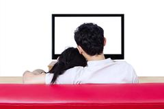 back view of couple watching tv on white - stock photo