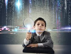 Young boy looking for malicious code Stock Illustration