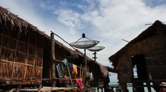 Surin Islands native village huts with TV dish - stock footage