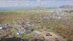Aerial along a destroyed town after Haiyan Stock Footage
