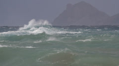 Long shot waves storm island turquoise - stock footage