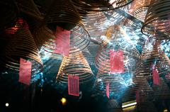 Incense coils hang from the ceiling of Man Mo Temple, Hong Kong Island Stock Photos