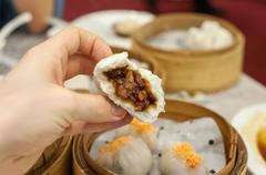 Cha Siu Bao barbequed pork bun at Hong Kong dim sum restaurant Stock Photos