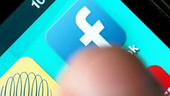 Facebook App  Launching On Smartphone iPhone - stock footage