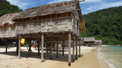 Native sea gypsy thatched village house, Surin Islands - stock footage